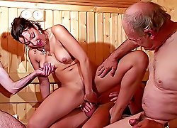 Beautiful naked chick gets all the fucking she ever wanted taking three stiff old cocks in a wooden steam room