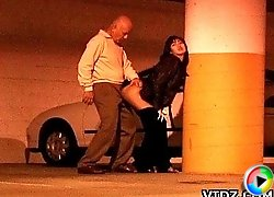 Hot and wild brunette asian whore China Doll fucking on a public parking space then gets a cum shot from the old man!