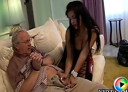 Naughty whore, Cory Everson gives this old guy a stimulating handjob!